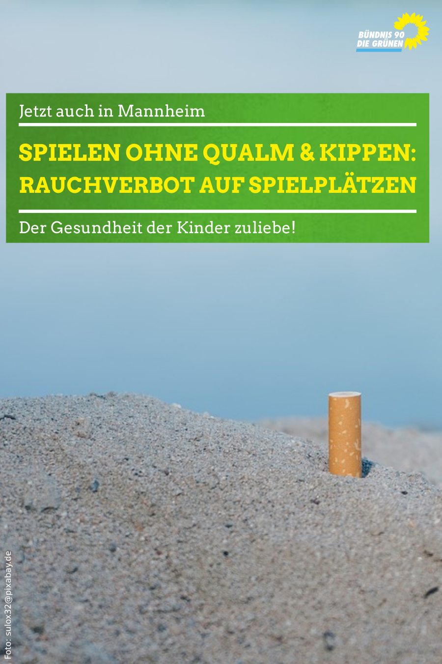 Zigarettenkippe in Sand
